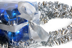 Tinsel and box with christmas balls Royalty Free Stock Images