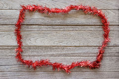 Tinsel Christmas decoration on wood background Royalty Free Stock Images