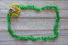 Tinsel Christmas decoration on wood background Stock Photos