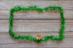 Tinsel Christmas decoration on wood background Royalty Free Stock Photo