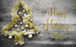 Tinsel Christmas Tree, calligrafia, feste felici fotografia stock libera da diritti