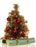 Tinsel christmas tree with presents and crackers Royalty Free Stock Image