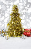 Tinsel Christmas tree in snow Stock Images