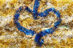 Tinsel decoration for a Christmas fur-tree Stock Images
