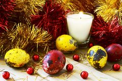 Tinsel and Easter eggs by candlelight Stock Photos
