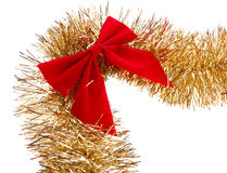 Tinsel garland and bow Royalty Free Stock Image