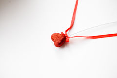 Tinsel heart. Red Tinsel heart valentine gift royalty free stock images