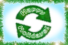 Tinsel style winter holidays greeting card. Abstract tinsel style winter holidays greeting card in blue, green and white with recycling logo Royalty Free Stock Photo