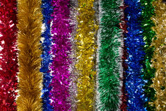 Tinsels of different colours. Royalty Free Stock Photos