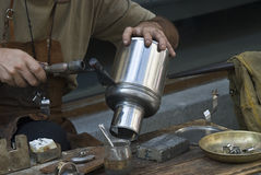 A tinsmith working. Royalty Free Stock Image