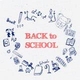Tinta azul de nuevo a garabatos de la escuela con el libro, bolso Imagenes de archivo