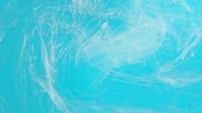 Tinta branca e azul na água Foto de Stock Royalty Free