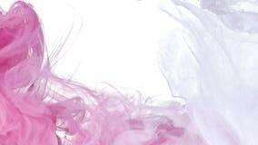 Tinta branca e cor-de-rosa na água Imagem de Stock Royalty Free