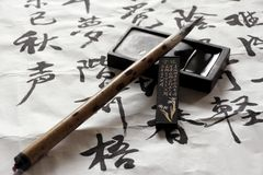 Tinta, escova e pedra Foto de Stock