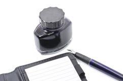 Tinta, pena e caderno Fotografia de Stock Royalty Free