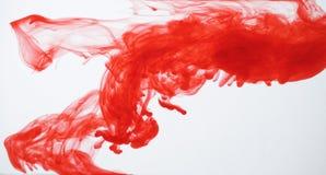 Tinta roja en agua clara Fotografía de archivo libre de regalías