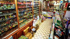 Tintagel, Cornwall, UK - April 10 2018: Interior of a traditional antique toy and game retailer, with wooden cases full of retro stock photography