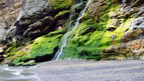 Tintagel green waterfall floating in the sea Royalty Free Stock Images