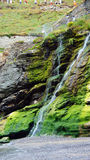 Tintagel green waterfall floating in the sea Royalty Free Stock Photos