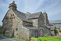 Tintagel Post Office. Tintagel Old Post Office is a 14th-century stone house, built to the plan of a medieval manor house, situated in Tintagel, Cornwall Stock Photo
