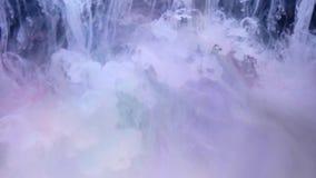 Tintas en el agua, explosión del color almacen de metraje de vídeo