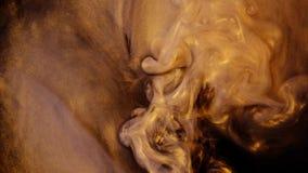 Tinte, die in Wasser, gelb und schwarz ausgelaufen wird Tinten im Wasser Bunte abstrakte Rauchexplosionsanimation stock footage