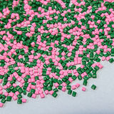 Tinte polimérico pelotillas plásticas Colorante para los gránulos Gotas del polímero Imagenes de archivo