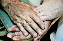Tinted color image of old married couples hands. horizontal Stock Photo