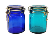 Tinted glasses. Two tinted food jar with covering isolated on white Royalty Free Stock Photo
