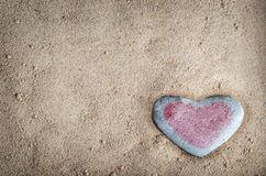 Tinted Heart Stone on Sand Stock Images