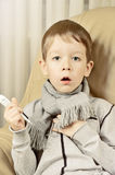 Tinted image boy coughing and holding a thermometer. Vertical Royalty Free Stock Image