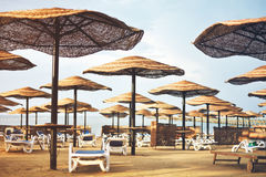 Tinted image hotel beach area with umbrellas and sun loungers, h. Orizontal Stock Photos