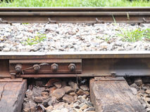 Tinted metal old screw on rail track. Tinted metal old screw on railway track, in its position Stock Photos