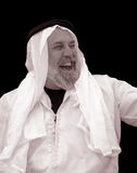 Tinted Portrait of a Very Happy, Laughing Sheik Royalty Free Stock Photography