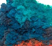 Tintenspritzen des abstrakten Farbenhintergrundes multi Farbim Wasser lokalisiert auf weißem Hintergrund Stockbilder