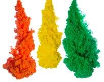 Tintenspritzen des abstrakten Farbenhintergrundes multi Farbim Wasser lokalisiert auf weißem Hintergrund Lizenzfreies Stockfoto