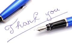 Tintenstift und -schreiben danken Ihnen Stockbild