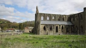 Tintern Abbey Monmouthshire near Chepstow Wales UK ruins popular tourist destination pan. Tintern Abbey Monmouthshire near Chepstow Wales UK ruins of Cistercian stock video footage