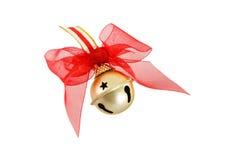 Tintinnio Bell di natale dell'oro con l'arco rosso Fotografie Stock