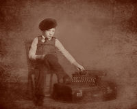 Tintype of little boy and typewriter. Little boy with typewriter tintype Royalty Free Stock Photography