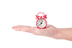 Tiny alarm clock in hand Stock Photo