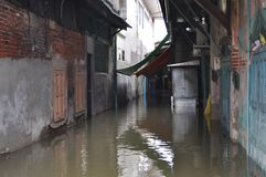 A tiny alley is flooded in Bangkok, Thailand, on the 30 November 2011 Royalty Free Stock Photography