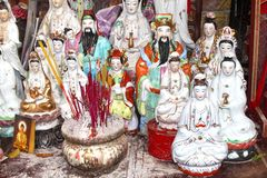 Tiny altar with incense and little Buddha statues Royalty Free Stock Photo
