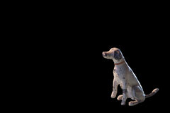 Tiny antique lead dog miniature, against black with copy space Royalty Free Stock Photography