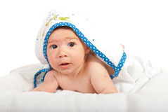 Tiny baby in bathrobe Royalty Free Stock Photo