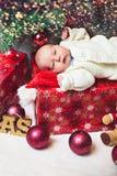 Tiny Baby Lying On A Christmas Gift Box Royalty Free Stock Image