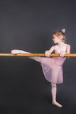 Tiny Ballerina. Young ballet dancer wearing an apricot tutu stock photos
