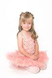 Tiny Ballerina. Young ballet dancer wearing an apricot tutu royalty free stock photos