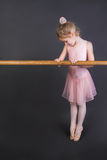 Tiny Ballerina. Young ballet dancer wearing an apricot tutu royalty free stock photo