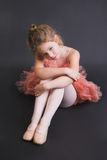 Tiny Ballerina. Young ballet dancer wearing an apricot tutu stock images